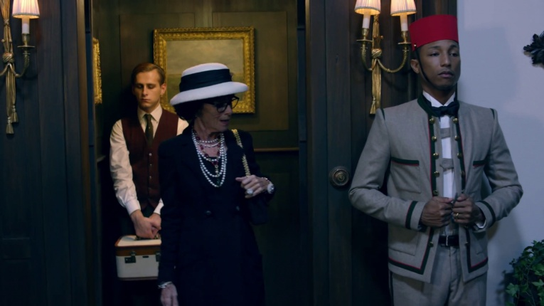 A lift boy's (Pharrell Williams) uniform inspires Coco Chanel (Geraldine Chaplin) to create the famous Chanel jacket